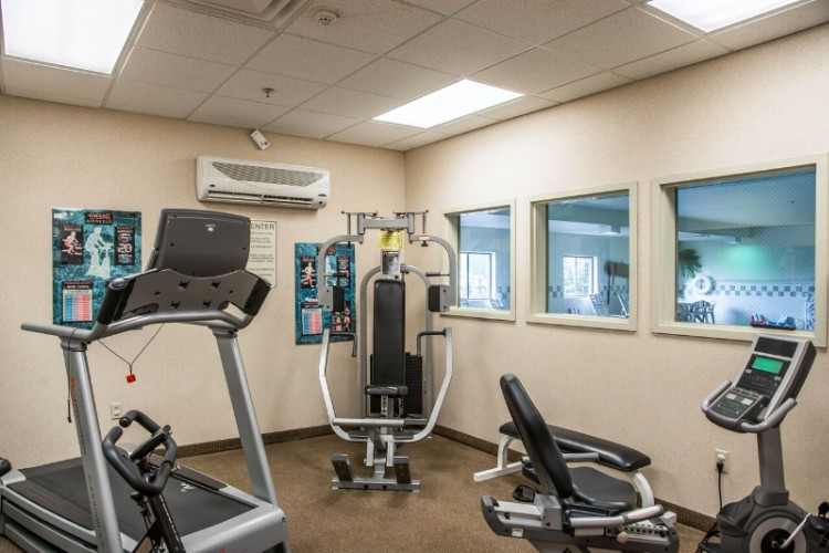 Exercise Room With Cardio Equipment And Weights 14 of 14