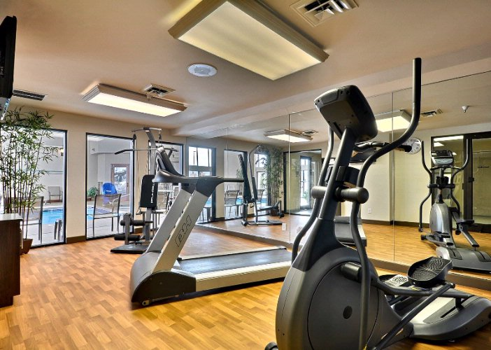 Fitness Center With Cardio Equipment & Weights 10 of 13