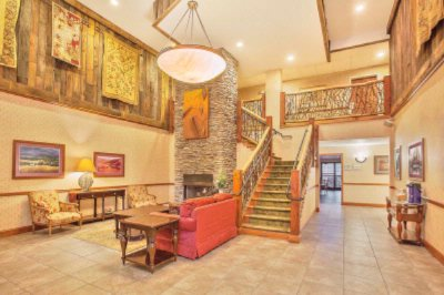 Interior Lobby With Fireplace And Grand Staircase 4 of 9