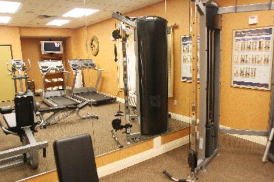 Maintain Your Fitness Routine In Our Well Equipped Exercise Room 9 of 10