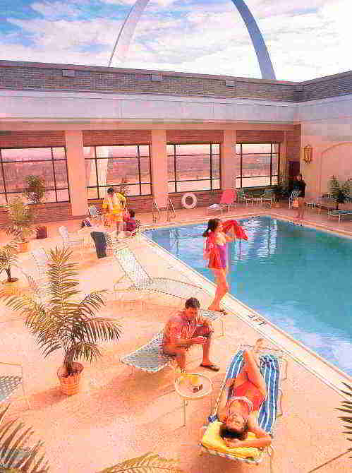Relax at the indoor or outdoor pool 3 of 8