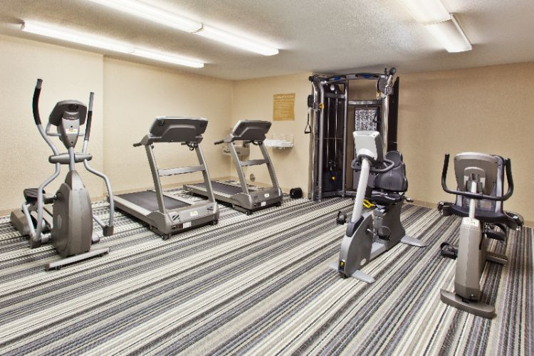 Stay Fit In Our Gym With 24/7 Access And Up To Date Machines Including Hand Weights And Yoga Equipment! 11 of 11