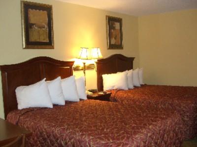 Room With Two Double Beds For Corporate Or Leisure Travel. 9 of 11