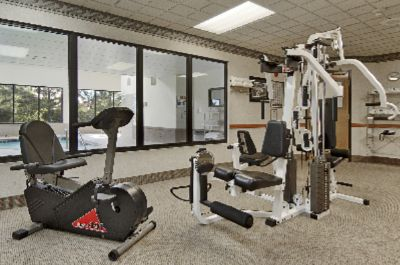 Fitness Center Features Treadmill Exercise Bike And Elliptical Trainer. 6 of 11