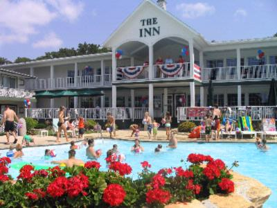 The Inn At Okoboji Centers Fun Around It\'s Pool Terrace And Cafe/lounge. 2 of 31