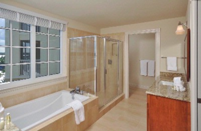 Guest Suite Bathroom Equipped With Heavenly Shower And Bath Products 10 of 26